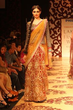 color contrast and chic style - A great idea to use wedding lehenga with a brocade blouse and a georgette dupatta, especially when you can't use such a grand lehenga anywhere other than D day