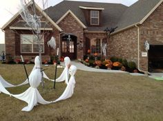 Decoration:Creepy Diy Outdoor Halloween Decoration Ideas With Five White Similarly Ghoulish And Some Pumpkins Decorated With Skull Ornament Hanging In Front Of The Entrance Also A Large Spider On The Roof Of The House Inspiring DIY Halloween Decorations for An Amazing Woow-ed Outdoor Halloween Party