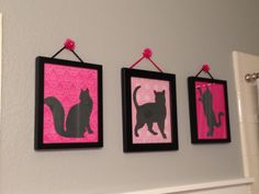 "DIY Wall decor for daughter's ""Pink Cats in Paris"" bathroom- Enlarged and printed cat silhouettes from internet, traced onto dark gray cardstock and cut out.  ModPodged those to colorful scrapbook papers and placed into existing frames.  Wrapped little craft toile flowers that have a wire attachment around nails on the wall."