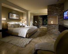 See 13 photos from the scrapbook Sweet Dreams are Made of These by Kelli Malin. #bedroom #fireplace #homeinspiration #shagrug #recessedlight #stone #white #taupe