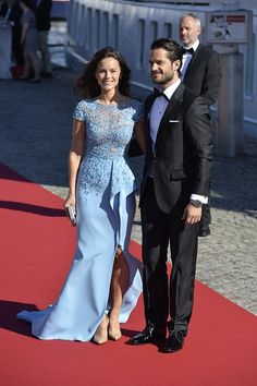 Sofia Hellqvist (L) and Sweden's Prince Carl Philip pose for photographers upon arrival for the pre-wedding party on the eve of their wedding on June 12, 2015 in Stockholm.