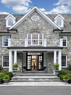 Stone Front House big house, lots of windows, and nice landscapingcould use some