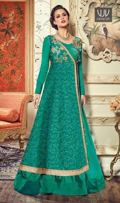 Glamorous Green Color Silk Designer Floor Length Suit  Make the heads flip when you dress up with this green color silk designer floor length suit. The resham and embroidered work on attire personifies the complete appearance.
