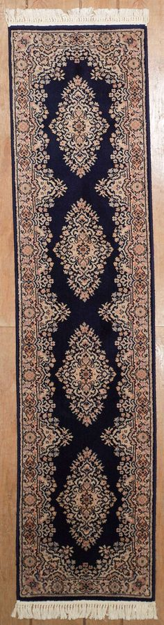 Machine made rectangular runner area rug with Persian Tabriz patterns in blue with beige accents, 2x9. Imported from India with wool. Free Shipping within the US.