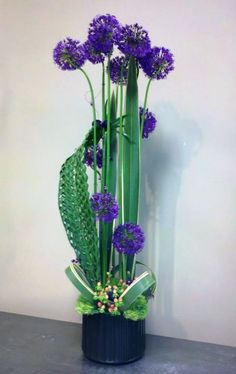 """A structural floral design created for a """"Grand Opening"""" of a design firm.  Features allium and exotic foliages.  Designed by Blumz... by JRDesigns, Detroit, Michigan.  blumz.com"""