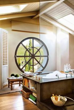 Luxury bathroom with round window (via CEPAYNASI)