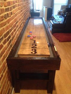 We are proud to announce that we have added reclaimed wood shuffleboard tables to our product line!!! The table is an example of a simple table we built recently, each table is built to order!  These tables are built with 100+ year old reclaimed hemlock and oak from in and around Baltimore City.  Each table includes a set of regulation pucks, silicon sand, and 2 abacus scoreboards that go up to 60!  We can build tables from 8-22 (anything over 14 will require special shipping and handling…