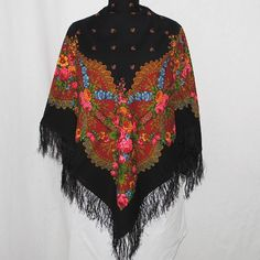 """Russian Pavlov Posad Woolen Shawl Silk Fringe by Ushanka-hat. $94.99. Among unique, world-wide known products, presenting pride and glory of Russia, a particular place occupy shawls from an ancient town of Pavlovsky Posad  Every year """"Pavlovo Posad Shawl Manufactory"""" issues around 300 kinds of shawls, kerchiefs, scarves, cache-nez, tablecloths of natural fibers: wool, cotton, silk. Recognition of a high art and cultural value of our products is the fact that to the facto..."""