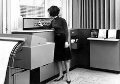 My first computer, the IBM 360/20 (1973).  Only my skirt was waaaay shorter! This looks like the computers I first worked on in the 60s.