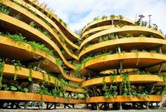 This Infinite Green sculpture in Wroclaw, Poland is a spiral-shaped wooden building covered entirely with hanging plants. Built from steel and wood, the sculpture houses over 100 different plant species - 3,000 plants in total - distributed across seven shelves and 110 square meters of space. The designer, Adam Kalinowski, created the piece for the European Capital of Culture Wroclaw 2016 art program.