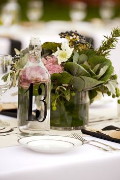 Love these centerpieces with the number on the bottle