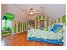 This bedroom is any little girl's dream. The white and green stripes really make this room stand out. Listed for $1,499,900.