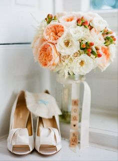 White, coral, and peach bouquet of garden roses, and berries. Cute scrabble letter detail!