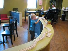 I like this idea for a miniature wall separating the play area from the coffee area