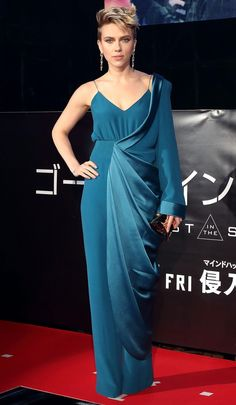 Scarlett Johansson in a teal one-sleeve jumpsuit