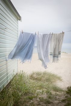 Beach ~ House. As a child, we hung our beach towels on the line when we came back from the beach. I vividly remember walking barefoot across the rocks and the cold outdoor showers! That's when I fell in love with the beach...