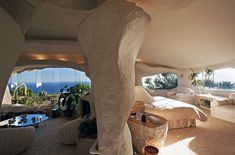 White plastered walls of this cave flintstone house. TV legend Dick Clark's house in Malibu.