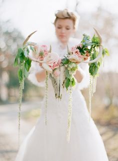 Whimsical Woodland Bridal Shoot Antlers Adorned With Flowers