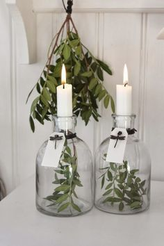 simple white christmas decorating idea: 2 vases, candles and some greens.