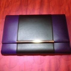 Ivanka Trump Travel Organizer Elegant Ivanka Trump travel organizer. Beautiful modern color blocking, hidden magnetic closure, interior zip pocket. Has a removable tabbed slip pocket for tickets, passport, documents and receipts. Logo- jacquard lining. Never used in perfect condition! Ivanka Trump Bags Clutches & Wristlets
