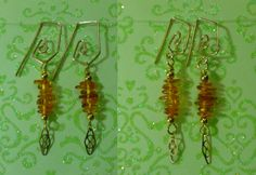amber earring charms on 2 different gold filled earwires... why gold filled? because it is still affordable and it is non reactive for those of us who cannot wear anything but pure metal.