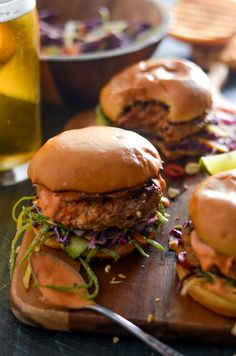 Thai Curry Turkey Burgers with Spicy Mayo and Coconut-Lime Slaw th Spicy Mayo and Coconut-Lime Slaw. Give up bland turkey burgers forever-- a little Thai curry paste makes all the difference in these flavor-packed patties. Burger Meat, Turkey Burgers, Veggie Burgers, Spicy Chicken Sandwiches, Thai Curry Paste, Sammy, Cooking Recipes, Healthy Recipes, Cooking Tips
