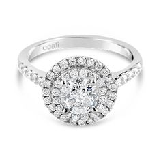 Ecali Presents: The timeless elegance of a round brilliant cut diamond surrounded by a claw set double halo upon a delicate diamond band adorns this white gold engagement ring.