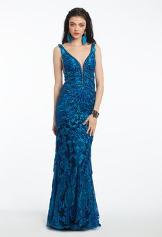 Give the blues a whole new meaning with this elegant evening gown! The plunging neckline, embroidered fitted bodice, open v-back and small train make this a picture-perfect wedding guest dress. #camillelavie