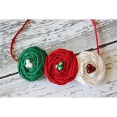 Classic Christmas Red Green and White Triple Rosette Headband ($13) ❤ liked on Polyvore featuring accessories, hair accessories, headbands & turbans, silver, turban headband, rose hair accessories, white rose headband, red headband and silver headband