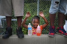 Gabrielle Walker, 5, protests the killing of teenager Michael Brown on Aug. 17 in Ferguson, Missouri. Scott Olson / Getty Images.  74 Of The Most Amazing News Photos Of 2014