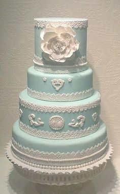 "Traditional Wedding Cake in a gorgeous shade of blue. Intricate detail with a front floral ""topper"". Beautiful cake! ᘡղbᘠ"