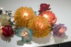 DIY Floral lights--using silk flowers--great idea for those Dollar Store silk flowers!