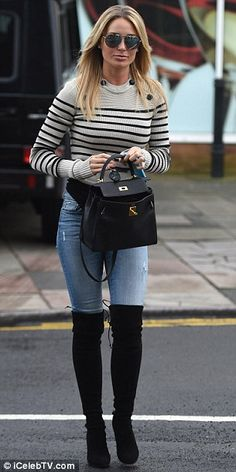 Well-heeled display: Further highlighting her toned pins, the blonde beauty rounded her look off with a pair of suede, block-heeled over-the-knee boots