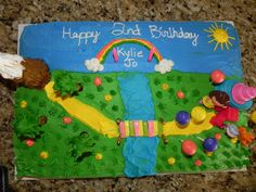 I did this cake for my daughter's 2nd birthday party.  She loves Dora so I made a cake like a dora episode.  I had a mountain, a bridge, and a fiesta!