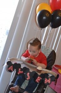 Mickey Mouse Birthday banner... wait... 2 year olds don't really do the whole highchair thing do they?