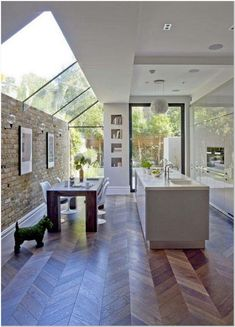 Beautiful space with custom skylight feature and herringbone wood flooring Kitchen Interior Design Beautiful custom Feature flooring herringbone inte skylight Space Wood