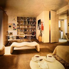 The flat of furniture designer Olivier Mourgue in Paris - the curvaceous chaise is one of his designs. Photo by François Puyplat; published in 'Young Designs in Living,' 1969.