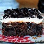 Marshmallow Oreo Fudge Poke Cake
