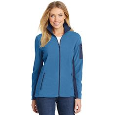 Port Authority L233 Ladies Summit Fleece Full-Zip Jacket - Regal Blue/Dress Blue Navy - When temps drop, trust our Summit Fleece to fight the chill. This midweight jacket has a contemporary look with clean design lines and a welded sleeve pocket for technical edge. | FullSource.com