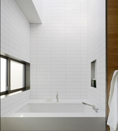 Stacked Large White Glass Subway tile in shower. Modern, clean bathroom tile. https://www.subwaytileoutlet.com/products/White-Glass-4x12-Subway-Tile#.VVzue_lViko