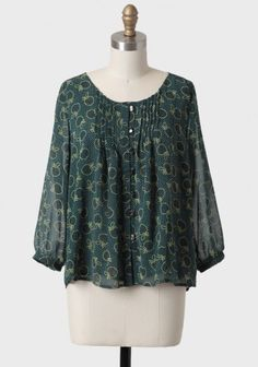 Sweet Treat Apple Print Blouse 39.99 at shopruche.com. Adorned with a sweet apple and dot print, this darling, semi-sheer forest green blouse features subtle pleating down the front and back. Finished with silver-toned front button closures. Fully lined.100% Polyester, Imported, 23