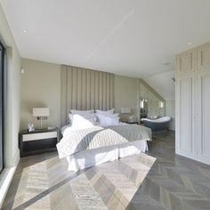 Chevron flooring that commands the bedroom