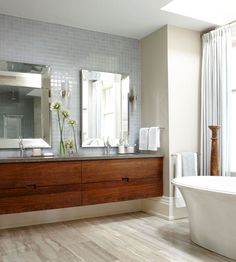 Floating Vanities A floating vanity updates any style of bath and makes the room feel airy by adding open space between the bottom of the vanity and the floor. A floating vanity can be as simple as a solid plank of wood with a vessel sink or, like this one, can be outfitted with double sinks and drawers for storage.