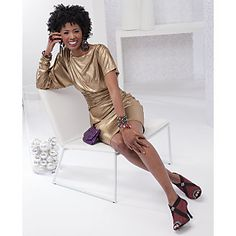 "For Your Hostesses - Deionne Shirred Dress from ASHRO - Metallic dress shimmers with style and boasts two different length sleeves for extra drama. This dress has shirring details with a bateau and V-neckline which enables it to be worn as a reversible dress. 40"" L. Lined. Available only in Gold. Polyester/Spandex Knit. Hand wash. Imported #PB26061."