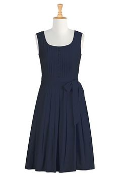 I <3 this Olivia dress from eShakti  -  navy blue, top tuxedo pleating with button front, sash, pleated skirt, classic, church, beautiful.  check out the entire site, nice clothes with tailoring available, decent prices, fast service, very large size range.        lj