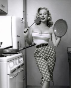Betty Brosmer in the kitchen...  One of my faves... look at that body... now THAT'S what I'D call an hour glass figure!