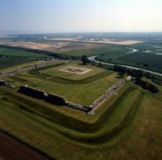 Richborough Roman Fort - Kent, England. This fort and township date back to the Roman landing in AD42, the fortified walls and massive foundations of a triumphal arch which stood 25 metres high still survive