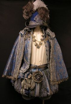"""Freddie Fox """"King Louis XIII"""" blue brocade ensemble with hat from The Three Musketeers. Costume designed by Pierre Yves Gayraud"""