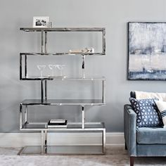 Part of our Stainless Steel Luxe range, this amazing unit is the ultimate luxury in displaying your favourite items in the living room. Made of solid steel and heavy glass shelves, it will stand the test of time while adding class and style. Studio Decor, Furniture Decor, Home And Living, Furniture Sale, Furniture, Interior, Lounge Furniture, Bookshelves, Steel Bookshelf