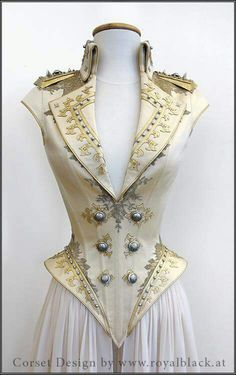 This corset is a beautiful balance of masculine edges, studs,  and the cream color. Feminine embellishments. Absolutely gorgeous balance.